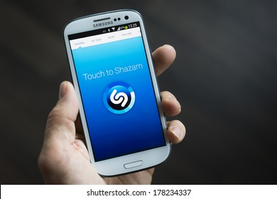 HILVERSUM, NETHERLANDS - FEBRUARY 23, 2014: Shazam, a music identification service, with headquarters in London. Founded in 1999 by Chris Barton, Philip Inghelbrecht, Avery Wang and Dhiraj Mukherjee
