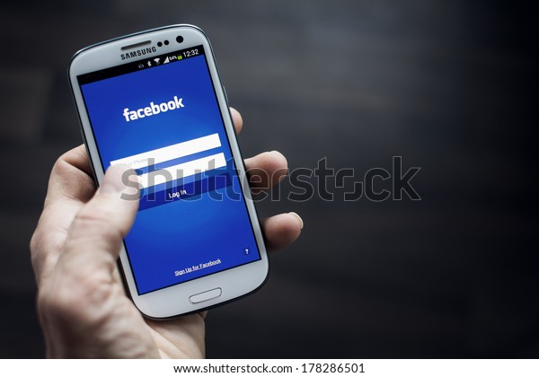 HILVERSUM, NETHERLANDS - FEBRUARY 23, 2014: Facebook is an online social networking service founded in February 2004 by Mark Zuckerberg with his college roommates and is now a fortune 500 company.