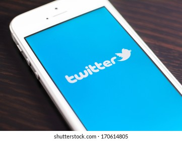 "HILVERSUM, NETHERLANDS - JANUARY 08, 2014: Twitter is an online social networking and microblogging service that enables users to send and read ""tweets"", limited to 140 characters."