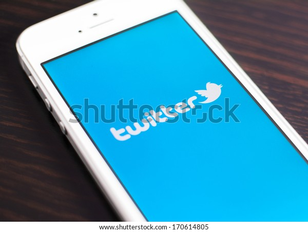 """HILVERSUM, NETHERLANDS - JANUARY 08, 2014: Twitter is an online social networking and microblogging service that enables users to send and read """"tweets"""", limited to 140 characters."""