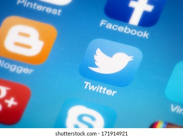 """HILVERSUM, NETHERLANDS - JANUARY 18, 2014: Twitter is an online social networking/microblogging service that enables users to send and read """"tweets"""", which are text messages limited to 140 characters."""