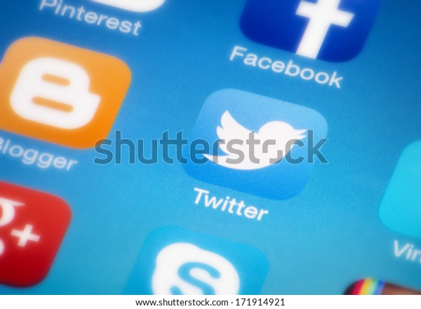 "HILVERSUM, NETHERLANDS - JANUARY 18, 2014: Twitter is an online social networking/microblogging service that enables users to send and read ""tweets"", which are text messages limited to 140 characters."