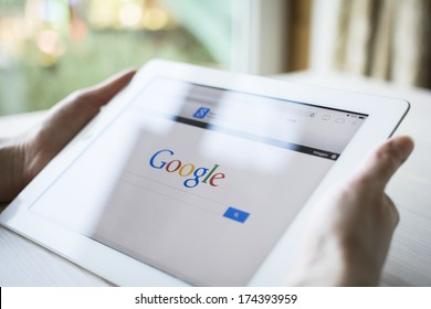 HILVERSUM, NETHERLANDS - JANUARY 31, 2014: Google is an American multinational corporation specializing in Internet-related services and products. Most of its profits are derived from AdWords.