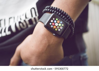 HILVERSUM, NETHERLANDS - March 03, 2017: Young man wearing Apple watch. Multiple Apps View.