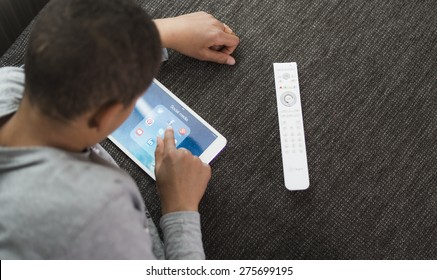 HILVERSUM, NETHERLANDS - May 03, 2015: More than half of children use social media by the age of 10. 43 per cent had messaged strangers, starting from an average age of 12