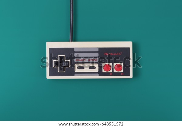 HILVERSUM, NETHERLANDS - May 15, 2017: Nintendo Entertainment System controller. Released in 1983, the NES was the best selling game console of its time with 61.91 million consoles sold world wide.