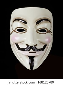 HILVERSUM, NETHERLANDS - MAY 20, 2013: Photo of Vendetta mask isolated on black. This mask is a well-known symbol for the online hacktivist group Anonymous. Also used for protests against governments.