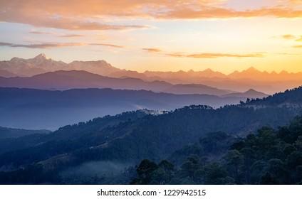 Himalaya mountain range at sunrise with moody sky as seen from Kausani Uttarakhand India.