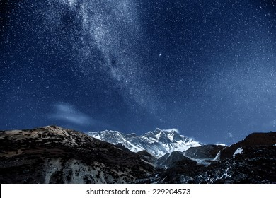 himalayan mountain Lhotse against dark blue sky with star in night time