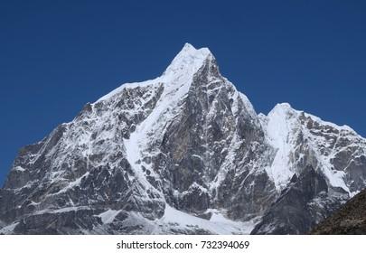 Himalayan mountain view on route to Everest Base Camp, Gokyo RI Peak and Pokalde Peak, Nepal. The Himalayas range has many of the highest peaks on Earth, including the highest Everest Mount Everest.