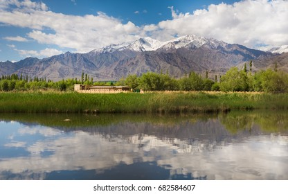 Himalayan mountains reflected in a small lake in Nubra Valley in Ladakh, India