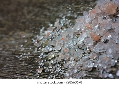 Himalayan pink salt crystals on old wooden table