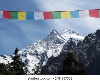 Himalayan prayer flags close to the mountains