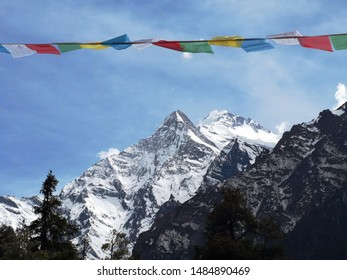 Himalayan prayer flags and mountains up in front