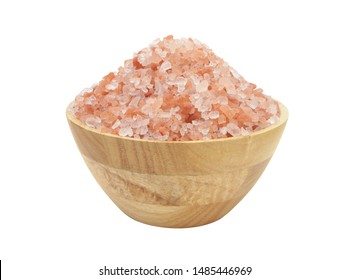 Himalayan rock salt in wooden bowl isolated on white background