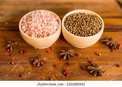 Himalayan salt and coriander seeds in bowls