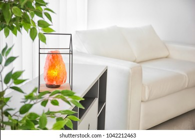 Himalayan salt lamp on shelving unit indoors