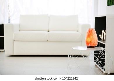 Himalayan salt lamp on table indoors