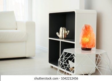 Himalayan salt lamp on table indoors