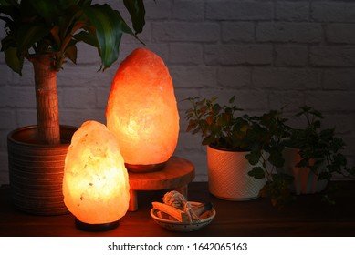 Himalayan salt lamps which can boost mood, improve sleep, ease allergies,reduce anxiety and clean the air. Warm orange colored light in dark room.
