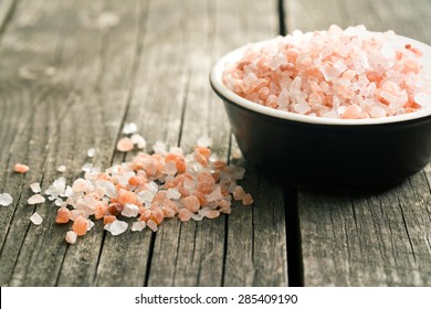 Himalayan salt on old wooden table