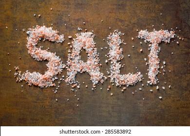 Himalayan salt on rusty background