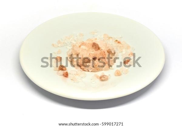 Himalayan salt pile on white background.