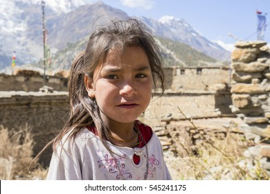 HIMALAYAS, ANNAPURNA REGION, NEPAL - OCTOBER 17, 2016 : Portrait nepalese child on the street in Himalayan village, Nepal