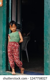 HIMALAYAS, EVEREST REGION, NEPAL - OCTOBER 20, 2018 : Portrait nepalese girl near her house,  on the street in Himalayan village, Nepal