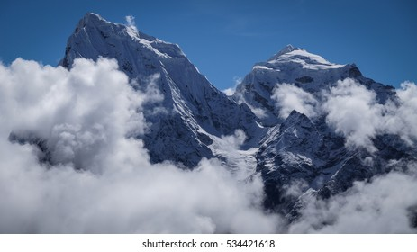 Himalayas. Himalaya Mountains of Nepal, snow covered high peaks and clouds