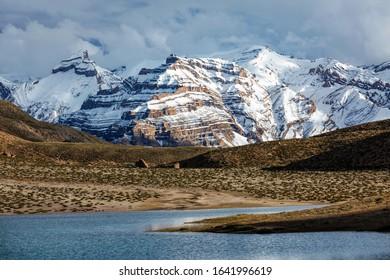 Himalayas mountains and mountain lake Dhankar Lake. Spiti Valley, Himachal Pradesh, India