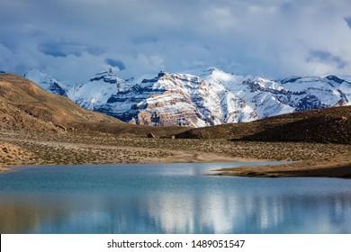 Himalayas mountains refelcting in mountain lake Dhankar Lake. Spiti Valley, Himachal Pradesh, India