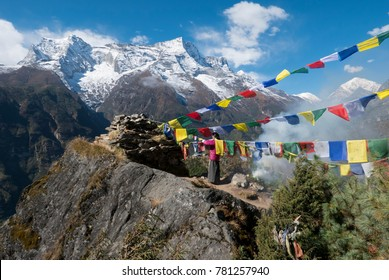 Himalayas, Nepal, 1 Nov 2017 - Nepali women replacing prayer flags close to Namche Bazaar village 3500 m above sea level in the Sagarmatha Park in Himalaya mountains