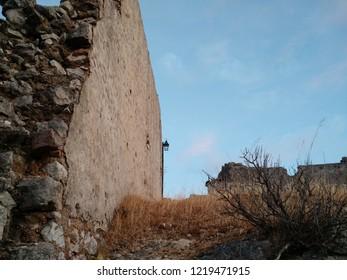 Himara, Albania - August 19 2016: Low angle view of ruined walls at Himara old town, Albania