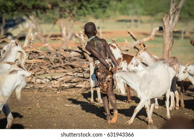 Himba boy with goat