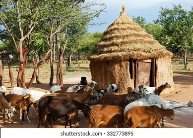 Himba village with traditional hut near Etosha National Park in Namibia, Africa