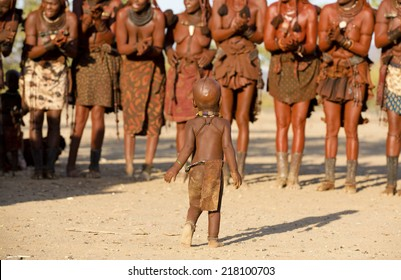 Himba women dancing and clapping hands at their village near Opuwo in Namibia