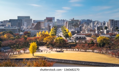 Himeji Castle, Hyogo Prefecture, Japan -November 8, 2018: View of Himeji Skyline from Himeji Castle with the boulevard, connecting the castle with the main train station, lined up with colorful trees.
