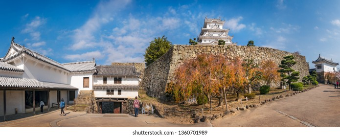 Himeji Castle, Hyogo Prefecture, Japan -November 8, 2018: People visiting Himeji Castle in autumn - Internal courtyard of Himeji Castle complex, one of the main touristic attractions in Japan.