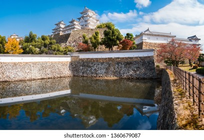 Himeji Castle panoramic view in autumn with reflections in the pond water. Himeji is considered the prototypical Japanese castle architecture and it is also he most famous and visited castle in Japan.