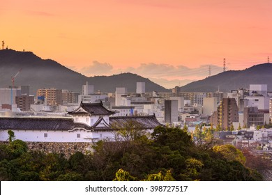 Himeji, Japan cityscape and castle corner tower.
