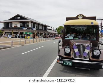 Himeji, JP - MAY 3, 2018: The retro vintage purple service car that picks up tourists transferring from Himeji Station to Himeji Castle.