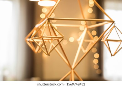 Himmeli - solstice symbol of Baltic and Scandinavian traditional Christmas decoration from reeds and golden Christmas lights on background