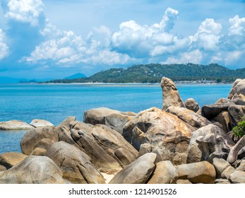 Hin ta, grandpa rock, giant stone look like penis (male genitalia) at beach in Samui island, Thailand, under cloudy blue sky