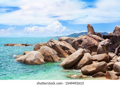 Hin Ta and Hin Yai rocks view close up, Grandmother and Grandfather stones on blue sea, sunny cloudy sky background, famous tourist natural landmark on Lamai beach, Koh Samui tropical island, Thailand