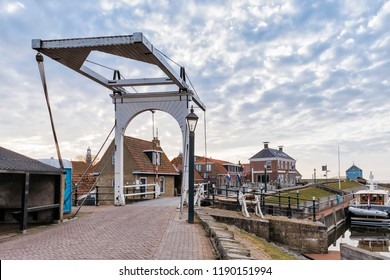 HINDELOOPEN, NETHERLANDS – MARCH 26, 2018: Old sluice and buildings in Hindeloopen, Netherlands.