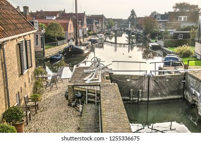 Hindeloopen, The Netherlands, November 4, 2018: view from the sluice towards the main canal through the historic town center