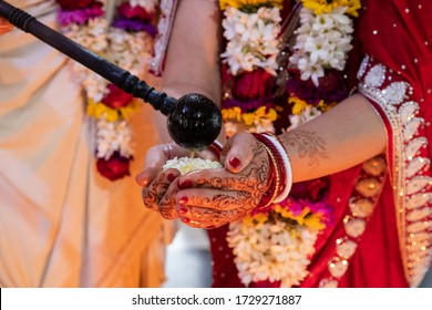 Hindu bride and groom held ghi in their hands, participating in the wedding ritual. Beautiful traditional Indian wedding ceremony. Hindu wedding. indian engagement. Hindu the Vedic Yagya ceremony - Shutterstock ID 1729271887