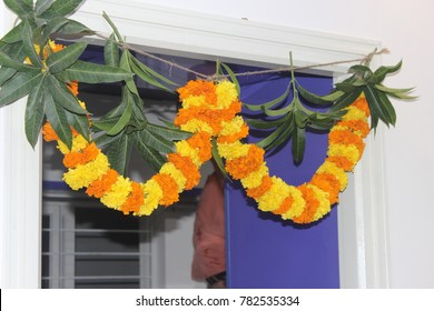 Hindu ceremony in india. On the occassion of festival the doorway decorated with beautiful flowers and leafs