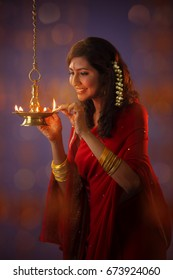 Hindu devotee lights earthen lamps as she celebrate Hindus Diwali Festival , Diwali, known as the 'Festival of Lights,